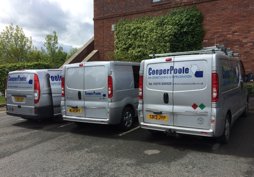 cooper poole vans parked beside wall